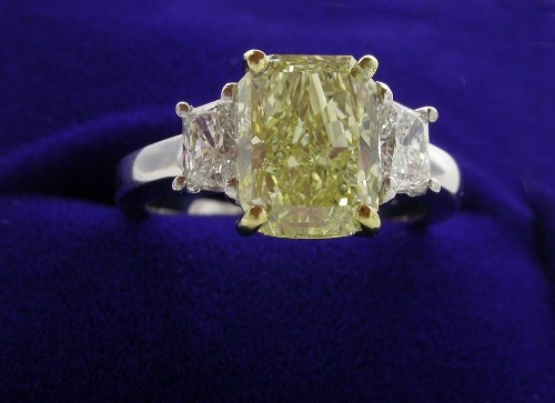 Radiant Cut Diamond Ring: 2.70 Carat Fancy Yellow 1.31 Ratio with 0.77 tcw Trapezoids