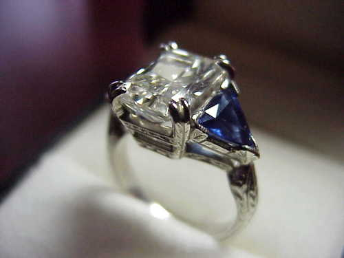 Radiant Cut Diamond Ring: 3.00 carat with 1.42 ratio and Blue Sapphire Trillions