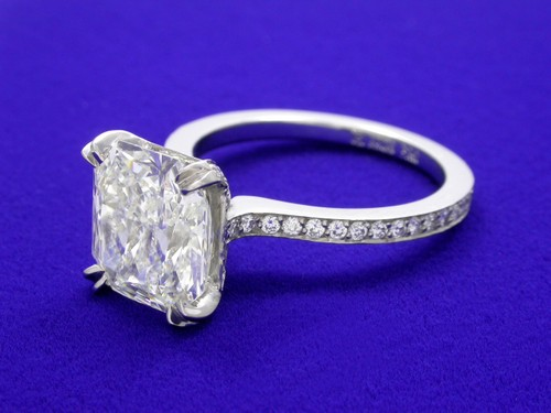 Radiant Cut Diamond Ring: 3.10 carat 1.12 ratio with 0.35 tcw side stones