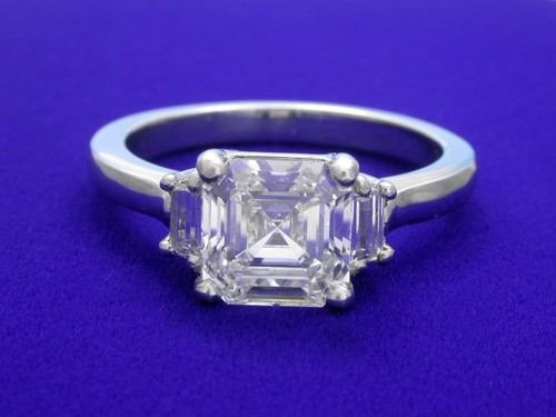Asscher Cut Diamond Ring: 1.58 carat with 0.20 tcw Step Cut Trapezoids