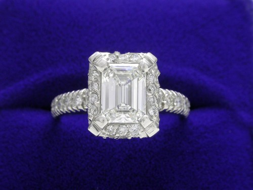 Emerald Cut Diamond Ring: 1.07 carat with 0.68 tcw pave mounting