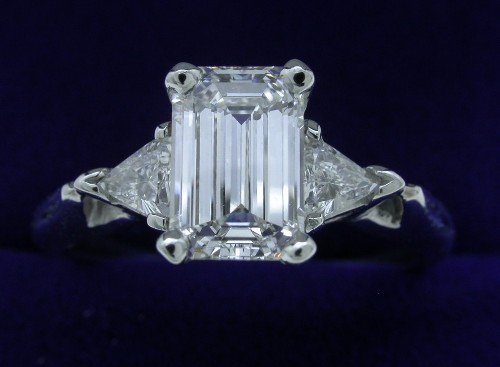 Emerald Cut Diamond Ring: 1.15 carat 0.26 Trillion side stones