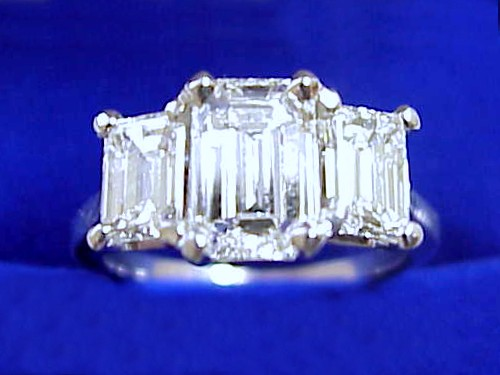Emerald Cut Diamond Ring: 1.18 carat 1.50 ratio with 0.99 total carat weight Emerald side stones