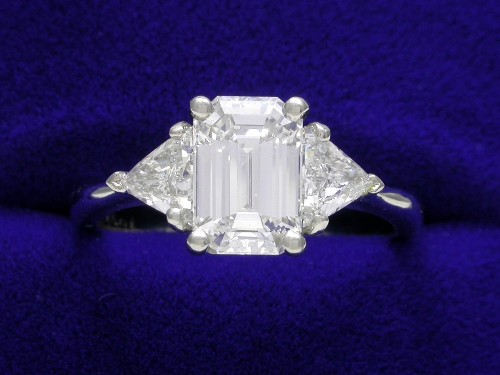Emerald Cut Diamond Ring: 1.26 carat 1.47 ratio with 0.49 tcw Trillion side stones