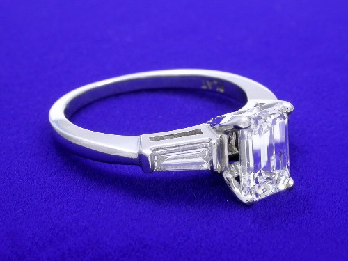 Emerald Cut Diamond Ring: 1.27 carat 1.50 ratio with 0.32 BG side stones