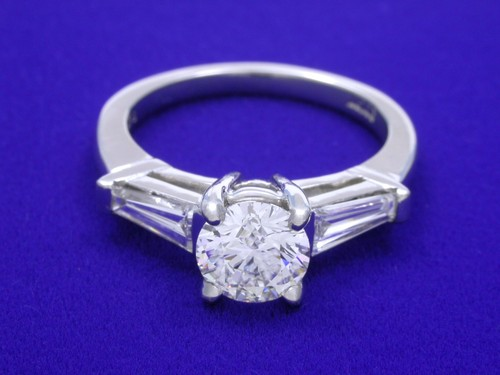 Round Brilliant Cut Diamond Ring: 0.89 carat with 0.45 tcw Tapered Baguette Diamonds