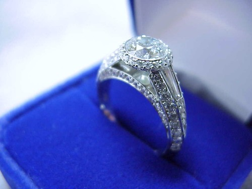 Round Brilliant Cut Diamond Ring: 0.90 carat with pave-set Bez Ambar designer mounting