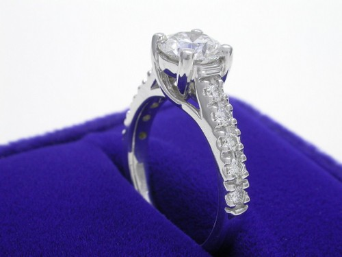 Round Brilliant Cut Diamond Ring: 0.96 carat with 0.25 tcw prong-set round diamonds