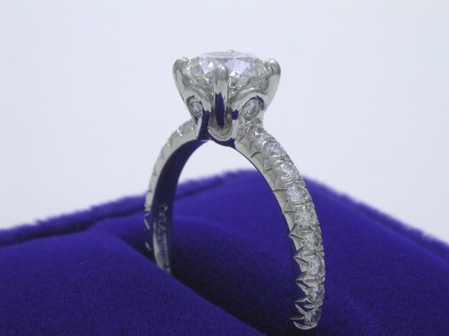 Round Brilliant Cut Diamond Ring: 1.01 carat in Saturn mounting with 0.37 tcw pave set diamonds