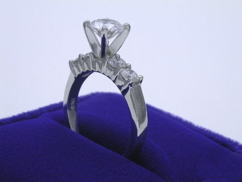 Round Brilliant Cut Diamond Ring: 1.01 carat with 0.65 tcw side stone in an Ingwer mounting