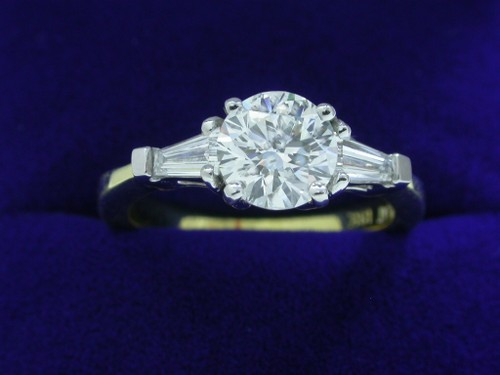 Round Brilliant Cut Diamond Ring: 1.03 carat with 0.35 tcw tapered baguette diamonds