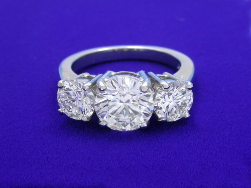 Round Brilliant Cut Diamond Ring: 1.52 carat with 1.19 tcw Round Diamonds