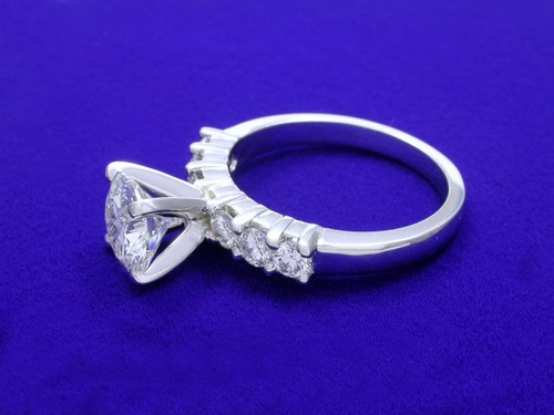 Round Brilliant Cut Diamond Ring: 1.56 carat with 0.60 tcw round diamonds in mounting