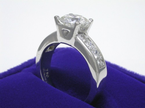Round Brilliant Cut Diamond Ring: 1.80 carat with 1.00 tcw Quadrillion Cut Diamonds