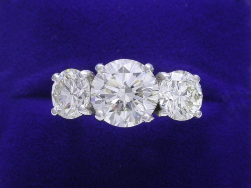 Round Brilliant Cut Diamond Ring: 3.00 carat with 2.54 tcw side Round Diamonds