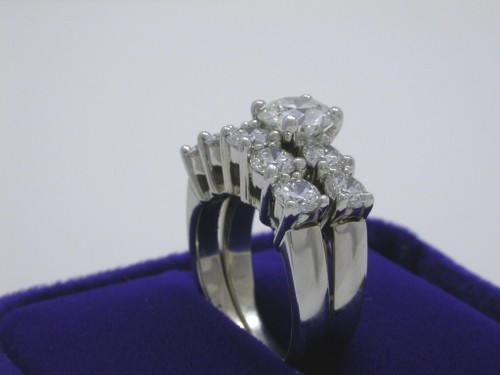 Round Brilliant Cut Diamond Ring: 1.20 carat with 0.85 carat sides and matching band